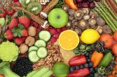 Liver detox health food concept with fresh fruit, vegetables, herbs, spices, nuts, grains and seeds. poster