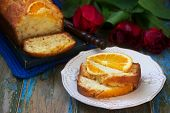 Orange Cake, Decorated With Slices Of Orange On A Background Of Juicy Oranges And A Bouquet Of Tulip poster