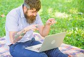 Man Bearded With Laptop Sit Meadow Nature Background. Writer Looking For Inspiration Nature Environm poster