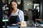 Asian Women Barista Smiling And Using Coffee Machine In Coffee Shop Counter - Working Woman Small Bu poster