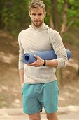 Stretch Muscles Pilates Practise. Sportsman Carries Yoga Mat For Outdoor Exercises. Outdoor Yoga Con poster