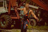 Bodybuilder Concept. Bodybuilder With Muscular Torso In Working Uniform. Bodybuilder Pull Heavy Iron poster