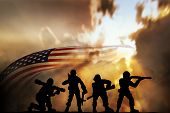 Silhouette Of Infantry On Sky Background. Veterans Day Concept poster
