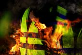 Yellow Vests Of Protest With Fire In France On Black Background.  Protester News Concept. poster