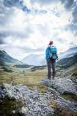 Female Blonde Mountain Climber With Backpack Is Enjoying The View poster
