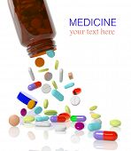 stock photo of antibiotics  - Pills come out from a medicine bottle - JPG