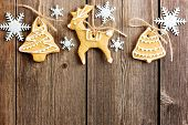 stock photo of biscuits  - Christmas homemade gingerbread cookies over wooden table - JPG