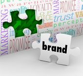 A puzzle piece with the word Brand is your final answer completing your marketing strategy to build