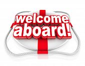 stock photo of life-boat  - Welcome Aboard words on a white and red life preserver to greet you with a friendly greeting - JPG