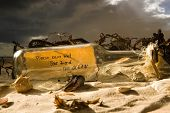 Message in a bottle on a beach containing a message with the words Please save me! Your Friend ~THE