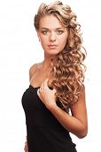 Portrait of  attractive young woman with long blond hair and beautiful stylish hairstyle. Isolated o
