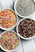 colorful candy sprinkles in ceramic bowl