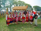 SUMY, UKRAINE - SEPTEMBER 22: Unidentified folk music band performs in traditional village backgroun