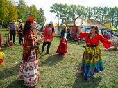 SUMY, UKRAINE - SEPTEMBER 22: Unidentified people wearing historical Gypsy costumes dancing on annua