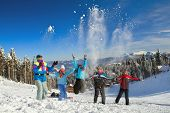 Young people throwing up snow in winter background