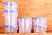 picture of tupperware  - Plastic containers for food on wooden background - JPG