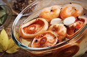 pickled mushrooms on glass bowl closeup