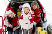 Winter, ski holidays, travel - family with baggage ready for the travel for winter holidays