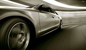 stock photo of tunnel  - 3d rendering of a brandless generic car of my own design in a tunnel with heavy motion blur - JPG