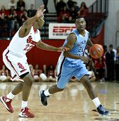 NEW YORK-NOV 3: Sonoma State Seawolves guard Emmanuel Bradford dribbles past St. John's Red Storm guard/forward Amir Garrett (22) at Carnesecca Arena on November 3, 2012 in Jamaica, Queens, New York.