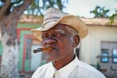 TRINIDAD,CUBA - JAN.13:Cuban man smokes a cigar on January 13, 2010 in Trinidad,Cuba. Cubans of all