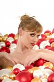 Sexy Young Woman Immersed In Christmas Balls