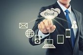 stock photo of globalization  - Business man pointing at cloud computing on virtual background - JPG