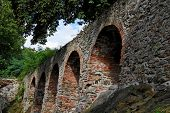 Red Brick Arches Of Old Medieval Castle poster