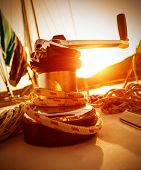 Closeup on crank handle of yacht in warm yellow sunset light, sailboat detail, active lifestyle, wat