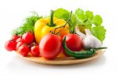 fresh vegetables with greens and spice isolated on white background