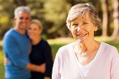 picture of mother law  - portrait of senior woman in front of middle aged son and daughter - JPG