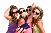 happy girls  taking photo of herself with cellular phone, Isolated on white background