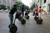 WASHINGTON, DC - JULY 29: Tourists stand on Segways as they listen to a guide during a Segway tour o