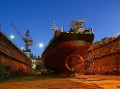 stock photo of dock  - Repair of a small ship to dock - JPG