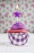 picture of lilas  - Purple cupcake with a star candle on it - JPG