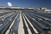 Pipes leading to solar panels at solar power plant