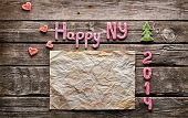 Sweet 2014 New Year holiday background. With old crumpled paper, small hearts and cute small Christmas trees.