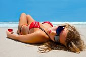 Attractive Girl Is Lying On The Beach