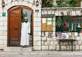 SARAJEVO, BOSNIA AND HERZEGOVINA - AUGUST 13, 2012: Religious Muslim man stands in doorway on street