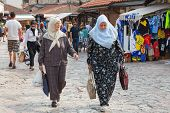 SARAJEVO, BOSNIA AND HERZEGOVINA - AUGUST 13, 2012: Muslim women walk on Bascarsija, the old town. S