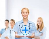 healthcare, medicine and technology concept - smiling female doctor or nurse with tablet pc computer