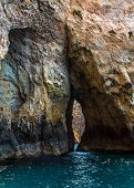 foto of grotto  - Crack in the middle of the cliff in the Blue Grotto in Malta - JPG