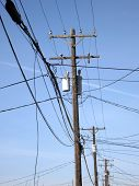 foto of utility pole  - Power lines and poles in town as a utility - JPG