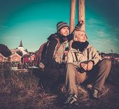foto of reining  - Young travellers couple in Reine village - JPG