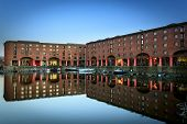 stock photo of dock  - The Albert Dock is a complex of dock buildings and warehouses in Liverpool England - JPG