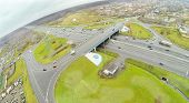 Bridge of Abramtsevskaya overpass on Moscow beltway at dull day. View from unmanned quadrocopter