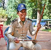 SIEM REAP, CAMBODIA - NOV 21, 2013: Unidentified Policeman play on traditional cambodian musical ins