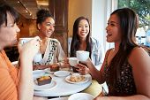 Group Of Female Friends Meeting In Caf�?�?�?�© Restaurant