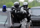 stock photo of terrorism  - Special force soldiers in anti terrorism action - JPG