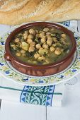 picture of bengal-gram  - Stew of chickpeas and spinach with cod on a table with a tablecloth - JPG